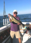 Capt. Tony with large walleye he caught